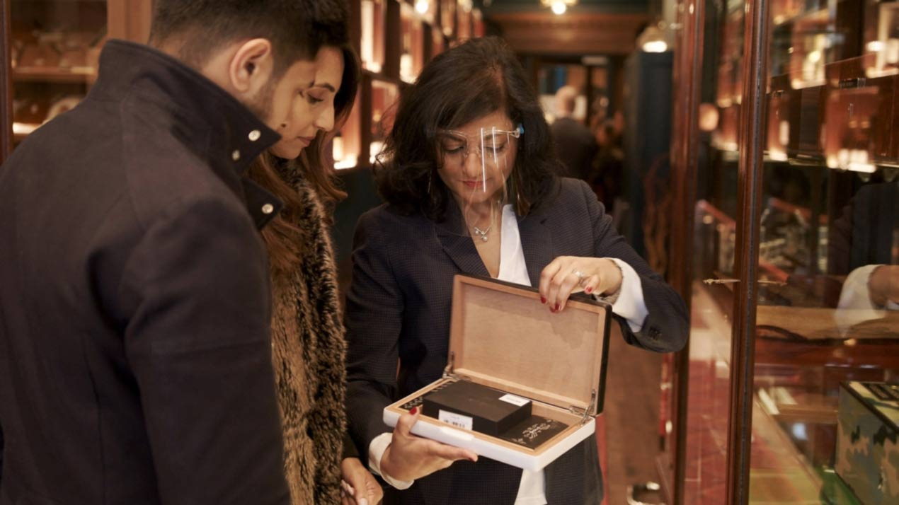 couple selecting humidor as gift from shop