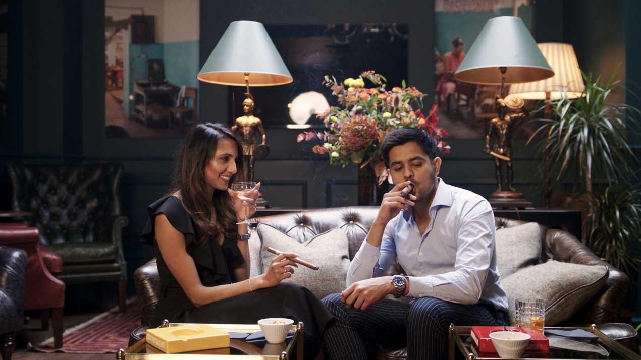 couple in lounge smoking cigars