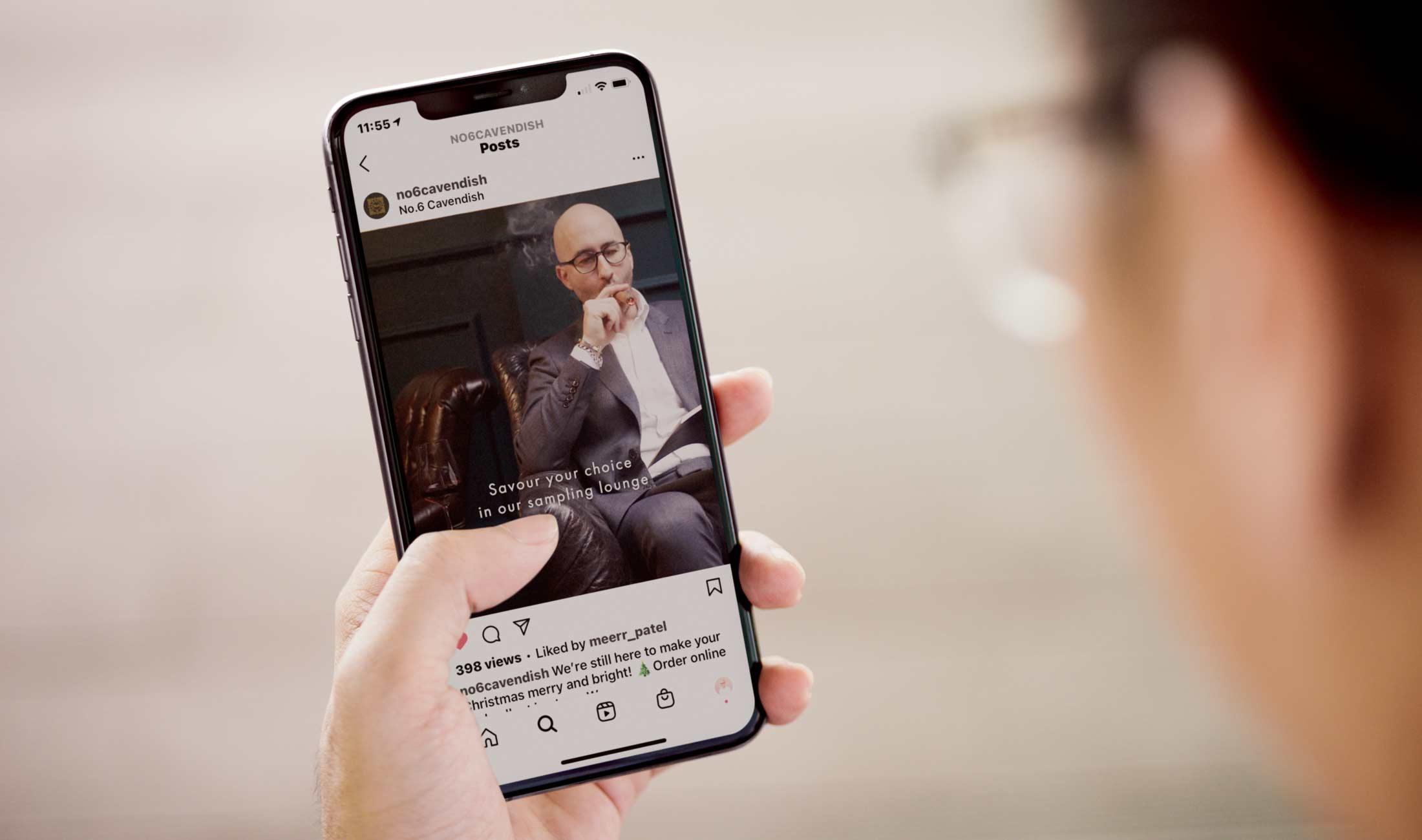man scrolling on smartphone