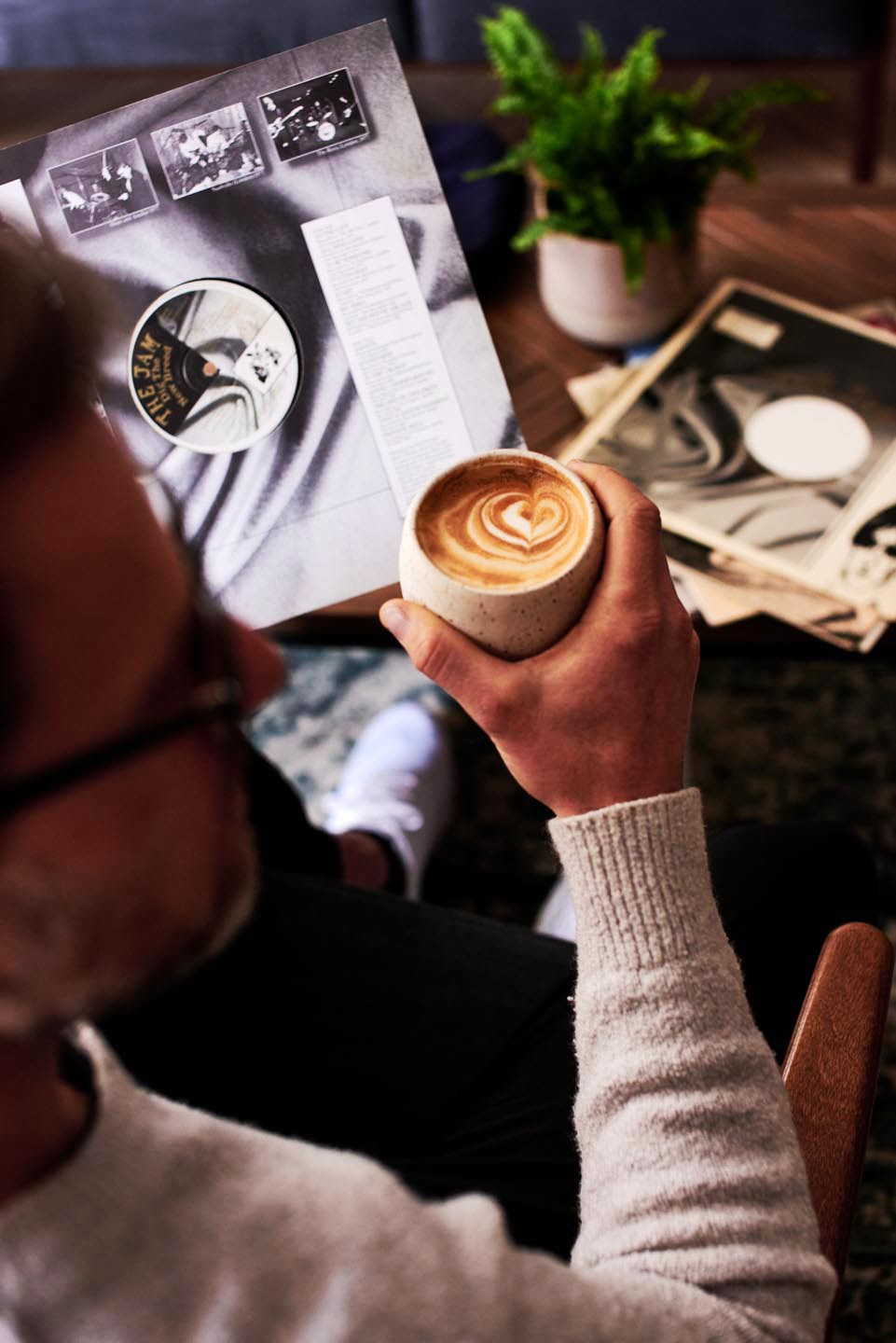 Relish Integrated Del Manning lifestyle photography brand photography man drinking coffee records